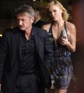 """Sean Penn, left, and Charlize Theron arrive at the Los Angeles premiere of """"The Gunman"""" at Regal Cinemas LA LIVE on Thursday, March 12, 2015. (Photo by Chris Pizzello/Invision/AP)"""