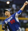 Los Angeles Dodgers starting pitcher Hyun-Jin Ryu throws during a spring training baseball game in Peoria, Ariz.  (AP Photo/Lenny Ignelzi)