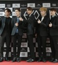 Many K-pop artists like EXO have English monikers for songs, albums and for their own names.  (AP Photo/Ahn Young-joon)