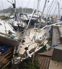 In this image provided by UNICEF Pacific, people on a dock view yachts damaged in Port Vila, Vanuatu, Saturday, March 14, 2015, in the aftermath of Cyclone Pam. Winds from the extremely powerful cyclone that blew through the Pacific\'s Vanuatu archipelago are beginning to subside, revealing widespread destruction. (AP Photo/UNICEF Pacific, Humans of Vanuatu)
