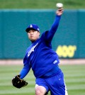 Los Angeles Dodgers starting pitcher Hyun-Jin Ryu, of South Korea, throws at a practice. (AP Photo/Charles Rex Arbogast)