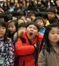 First graders attend an elementary school entrance ceremony in Seoul on March 2, 2015. (Yonhap)