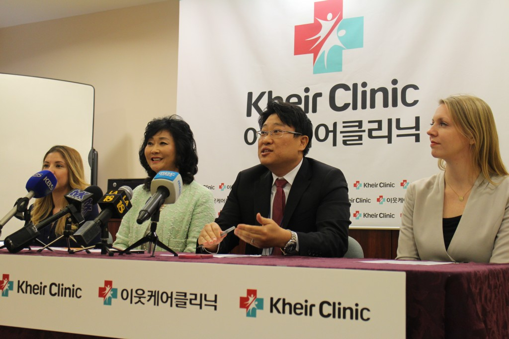 KHEIR CEO Erin Pak, second from left, and Director Moon Sang-woong announce the center's second clinic Tuesday. (Kim Chul-soo/Korea Times)