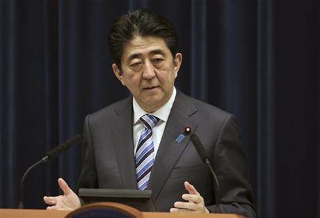 In this March 10, 2015 file photo Japanese Prime Minister Shinzo Abe speaks during a news conference at his official residence in Tokyo. Abe will become the first Japanese prime minister to address a joint meeting of Congress in late April, the House speaker has announced. Foreign leaders have been accorded the honor 111 times since World War II, but not Japan, despite the tight alliance forged with the U.S. in the 70 years since 1945. (AP Photo/Eugene Hoshiko, File)