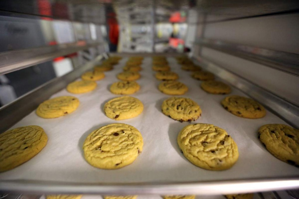 Freshly baked cannabis-infused cookies cool on a rack inside Sweet Grass Kitchen, an established Denver-based gourmet marijuana edibles bakery which sells its confections to retail outlets throughout the state. Edible marijuana sold in Colorado must look different from regular foods, state lawmakers from both parties said Wednesday, March 25, 2015, in rejecting a bill to loosen requirements. The 0-5 vote was a dramatic loss for the state's new marijuana industry, where many producers of edible pot complain that a requirement that their products not look like other foods and drinks goes too far. (AP Photo/Brennan Linsley, File)