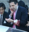U.S. Seoul envoy Lippert heads to a hospital after being attacked during a lecture. (Yonhap)