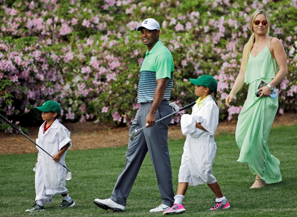 Tiger Woods walks with his children Sam and Charlie and Lindsey Vonn during the Par 3 contest at the Masters golf tournament Wednesday, April 8, 2015, in Augusta, Ga. (AP Photo/David J. Phillip)