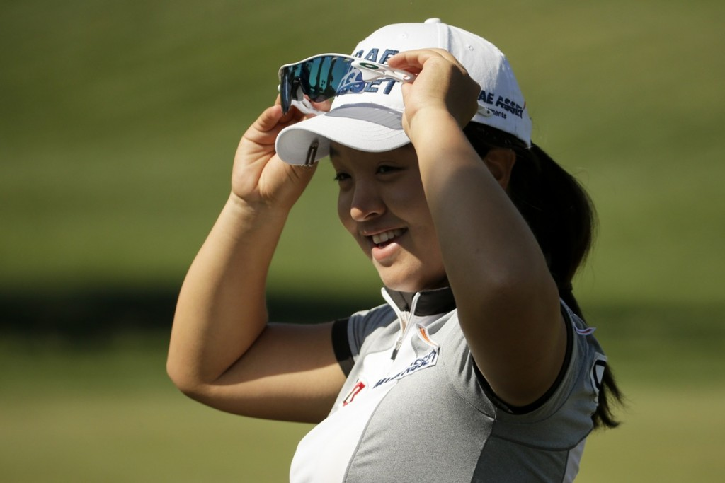 Sei Young Kim, of South Korea, smiles after a birdie on the ninth hole during the second round of the LPGA Tour ANA Inspiration golf tournament at Mission Hills Country Club Friday, April 3, 2015 in Rancho Mirage, Calif. (AP Photo/Chris Carlson)