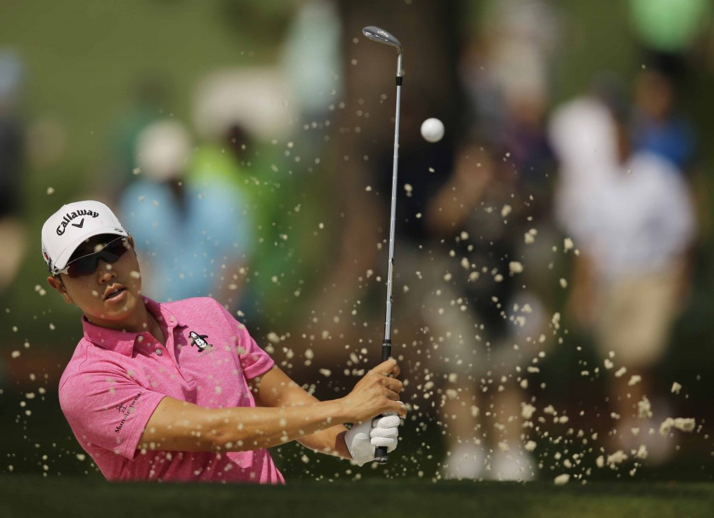 Bae Sang-Moon, of South Korea, hits on the seventh hole during a practice round for the Masters golf tournament Tuesday, April 7, 2015, in Augusta, Ga. (AP Photo/Matt Slocum)