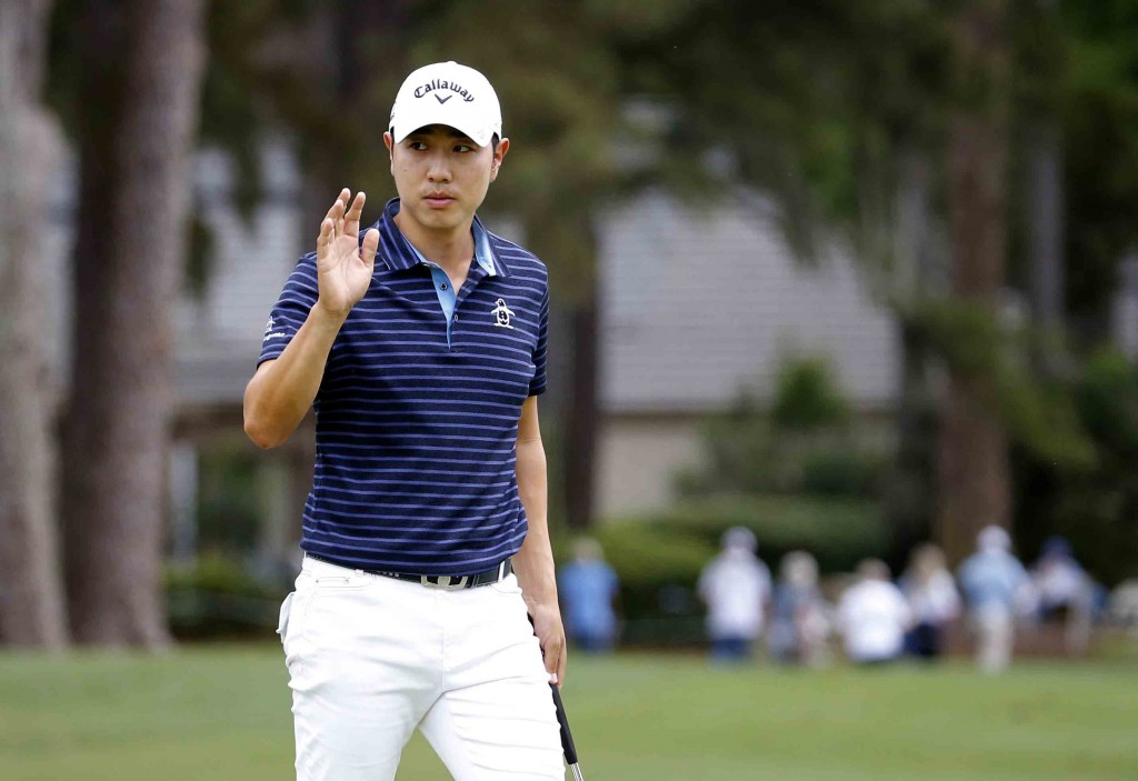 Bae Sang-moon, of South Korea, waves after making a birdie on the ninth hole during the second round of the RBC Heritage golf tournament in Hilton Head Island, S.C., Friday, April 17, 2015. (AP Photo/Stephen B. Morton)
