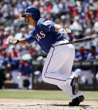 Texas Rangers' Shin-Soo Choo, of South Korea, reaches first after safely bunting down the third base line off a pitch from New York Mets' Dillon Gee in the first inning of an exhibition baseball game, Saturday April 4, 2015, in Arlington, Texas. (AP Photo/Tony Gutierrez)