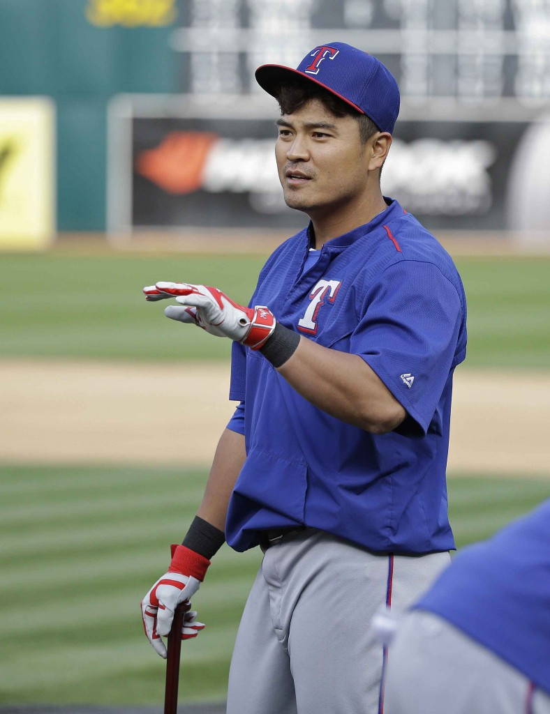 Texas Rangers left fielder Shin-Soo Choo of South Korea gestures while taking batting practice before the start of their opening day baseball game against the Oakland Athletics, Monday, April 6, 2015, in Oakland, Calif. (AP Photo/Eric Risberg)