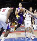 Los Angeles Clippers' J.J. Redick, right, tries to steal the ball from Los Angeles Lakers' Jeremy Lin, center, as Clippers' DeAndre Jordan, foreground, and Blake Griffin watch during the second half of an NBA basketball game, Tuesday, April 7, 2015, in Los Angeles. The Clippers won 105-100. (AP Photo/Jae C. Hong)
