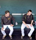 left, and Pirates second baseman Neil Walker in the dugout before a spring training exhibition baseball game against the New York Yankees at McKechnie Field in Bradenton, Fla., Thursday, March 5, 2015. (AP Photo/Gene J. Puskar)