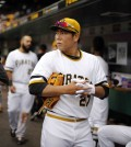 Pittsburgh Pirates' Kang Jung-ho of Korea, prepares to take the field during the seventh inning of a baseball game against the Milwaukee Brewers in Pittsburgh, Sunday, April 19, 2015. Kang took over at shortstop when Jordy Mercer was hit by a pitch and left the game. (AP Photo/Gene J. Puskar)