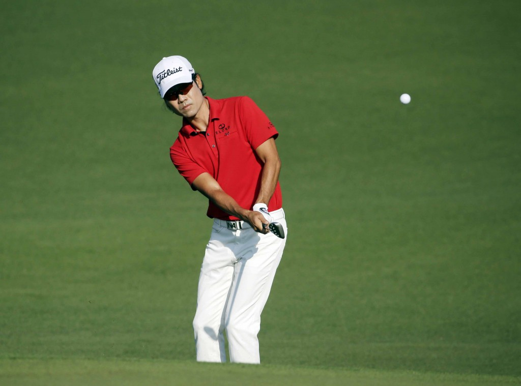 Kevin Na hits on the second fairway during the first round of the Masters golf tournament Thursday, April 9, 2015, in Augusta, Ga. (AP Photo/Chris Carlson)