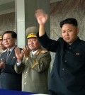 In this image taken from video North Korean leader Kim Jong Un, right, waves to spectators and participants during a military parade marking the 65th anniversary of the country's founding, Monday, Sept. 9, 2013, in Pyongyang, North Korea. (AP Photo/KRT via AP Video)