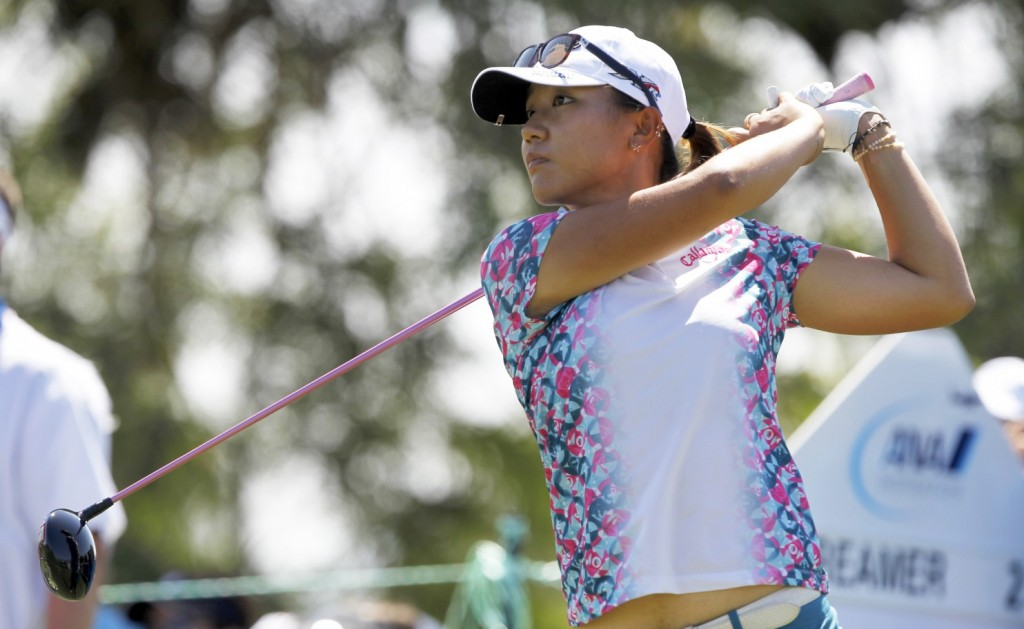 Lydia Ko, of New Zealand, hits her tee shot from the seventh hole during the final round of an LPGA Tour golf tournament at Mission Hills Country Club, Sunday, April 5, 2015, in Rancho Mirage, Calif. (AP Photo/Alex Gallardo)