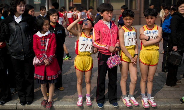 Young North Korean runners rest after finishing their part of the Mangyongdae Prize International Marathon in 2014. (David Guttenfelder/AP)