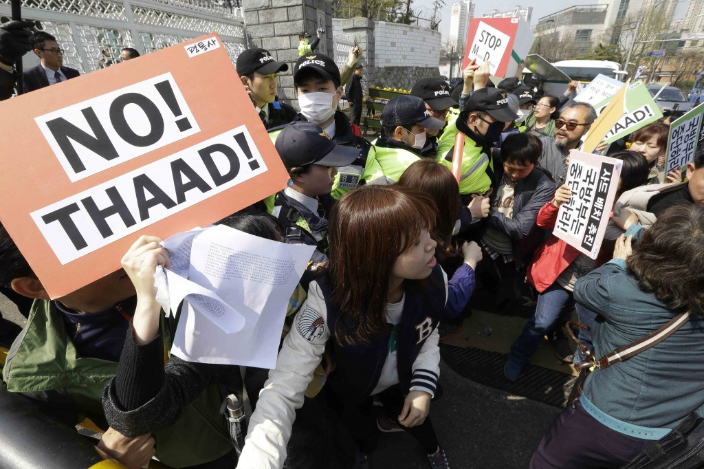 Protesters struggle with police officers as they march toward the Defense Ministry during a rally against the visit by U.S. Defense Secretary Ash Carter in Seoul, South Korea, Friday, April 10, 2015. Protesters opposed a possible deployment of a Terminal High-Altitude Area Defense (THAAD) system on Korea Peninsula. (AP Photo/Ahn Young-joon)