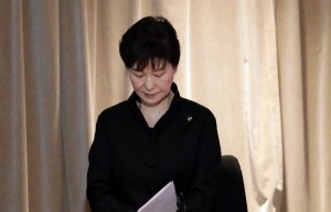 South Korea's President Park Geun-hye looks observes a minute of silence during a state funeral of the late Lee Kuan Yew, held at the University Cultural Center, Sunday, March 29, 2015, in Singapore. During a week of national mourning that began Monday after Lee's death at age 91, some 450,000 people queued for hours for a glimpse of Lee's coffin at Parliament House. A million people visited tribute sites at community centers across the island and leaders and dignitaries from more than two dozen countries attended the state funeral. (AP Photo/Wong Maye-E)