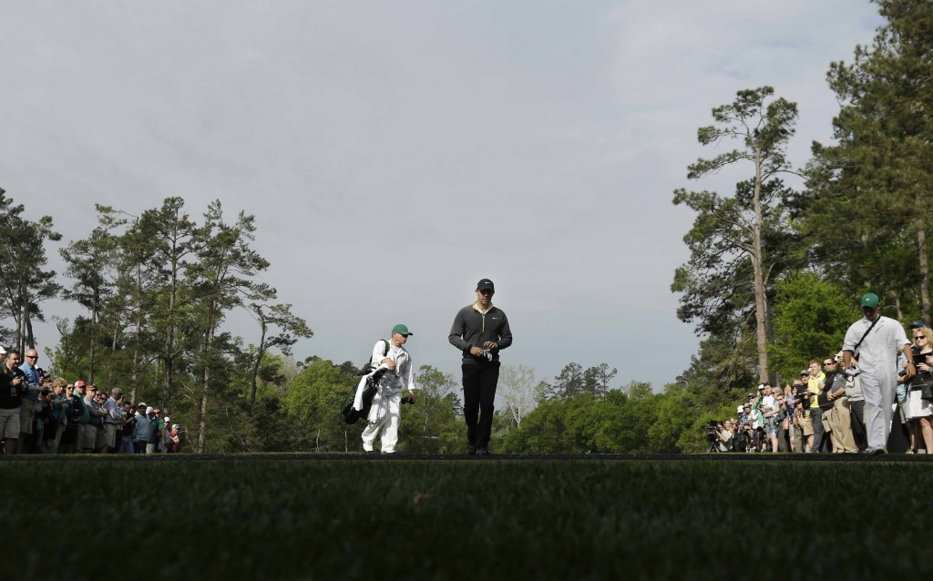 Rory McIlroy, of Northern Ireland, prepares to tee off on the fourth hole during a practice round for the Masters golf tournament Monday, April 6, 2015, in Augusta, Ga. (AP Photo/Charlie Riedel)