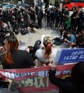 Sex workers hold a press conference in front of the Constitutional Court in Seoul on April 9, 2015 before attending the first public hearing on the constitutionality of the sex trafficking law. (Yonhap)
