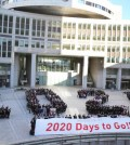 "In this Jan. 12, 2015 file photo, participants form human letters ""2020"" during a countdown event for the 2020 Tokyo Olympics in Tokyo. Organizers of the 2020 Tokyo Olympics promised the most innovative, impeccably run and ""sustainable"" Games ever. With just a little over five years to go, doubts are mounting that they might not deliver on that last pledge. On Tuesday, April 7, 2015, the World Wide Fund for Nature and others that are backing use of renewable energy, including Masato Mizuno, the sports-goods magnate who led Tokyo's bid for the games, issued a formal call for faster action. (AP Photo/Koji Sasahara, File)"