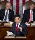 Japanese Prime Minister Shinzo Abe speaks before a joint meeting of Congress, Wednesday, April 29, 2015, on Capitol Hill in Washington. Vice President Joe Biden, left, and House Speaker John Boehner of Ohio listen. (AP Photo/Carolyn Kaster)