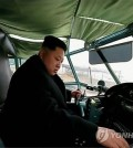 North Korean leader Kim Jong-un conducts a take-off and landing test of a newly-made light plane during a visit to a machine factory. (KCNA-Yonhap)