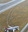 An Asiana Airlines plane sits at Hiroshima airport in Mihara, Hiroshima prefecture, western Japan Wednesday, April 15, 2015 after it skidded off a runway Tuesday. About 20 people received minor injuries, officials said. (Muneyuki Tomari/Kyodo News via AP)