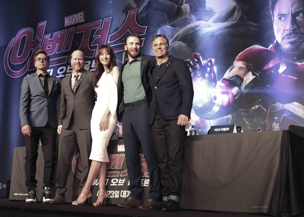 "From left, U.S. actor Robert Downey Jr., US director Joss Whedon, South Korean actress Claudia Kim actors, U.S. actors Chris Evans and Mark Ruffalo pose during a press conference to promote their latest film ""Avengers: Age of Ultron"" in Seoul, South Korea, Friday, April 17, 2015. The movie will open on April 23 in South Korea. (AP Photo/Ahn Young-joon)"