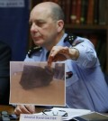General David Galtier displays a picture showing the second black box from the Germanwings plane that crashed in the French Alps last week, during a press conference in Marseille, southern France, Thursday, April 2, 2015. Brice Robin announced that a gendarme found the second black box flight recorder of Germanwings Flight 9525, blackened and buried in the soil of the Alps, and investigators hope to be able to analyse its data for more clues to what happened. (AP Photo/Claude Paris)