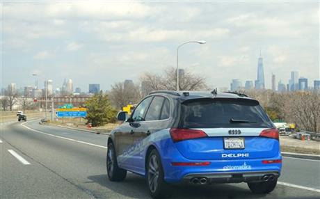 In this Monday, March 30, 2015 photo provided by Delphi Corp., the company's autonomous car approaches New York City, its final destination of a 3,400-mile road trip across the U.S., near Jersey City, N.J. Ninety-nine percent of the time, the car steered itself; only in very tricky situations, like a construction zone, did drivers take control. Now engineers will take the reams of data from the trip and use it to further advance autonomous technology. (AP Photo/Delphi Corp.)