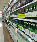 Bottles of soju line shelves at a Los Angeles Korean market.