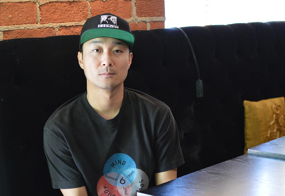 "Daniel ""DPD"" Park, director of ""K-Town Cowboys,"" inside Cafe Mak in Koreatown, Los Angeles. (Korea Times)"