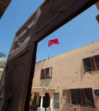 A flag flies over the Moroccan Embassy after a bomb placed in a garbage bin targeted the site in the capital, Tripoli. in Tripoli, Libya on Monday, April 13, 2015. There were no casualties in the attack, which was claimed by Libya's Islamic State affiliate. (AP Photo/Mohamed Ben Khalifa)