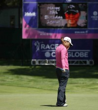 Lydia Ko, of New Zealand, reacts after missing a birdie putt on the ninth green of the Lake Merced Golf Club as a sign in the background wishes her a happy 18th birthday during the second round of the Swinging Skirts LPGA Classic golf tournament Friday, April 24, 2015, in Daly City, Calif. (AP Photo/Eric Risberg)