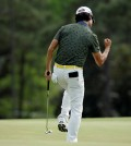 Kevin Na reacts to a birdie putt on the 18th hole during the second round of the Masters golf tournament Friday, April 10, 2015, in Augusta, Ga. (AP Photo/Matt Slocum)
