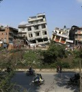 Damaged buildings lean to their sides in Kathmandu, Nepal, Monday, April 27, 2015. A strong magnitude 7.8 earthquake shook Nepal's capital and the densely populated Kathmandu Valley on Saturday, causing extensive damage with toppled walls and collapsed buildings. (AP Photo/Wally Santana)