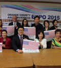 Community organization representatives pose for a photo during a press conference announcing the Orange County Asian Business Expo 2015.