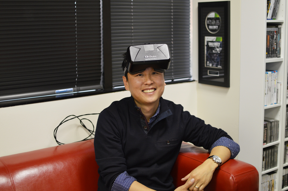 Taehoon Oh wears a Virtual Reality headset inside Reload Studios. (Tae Hong/Korea Times)