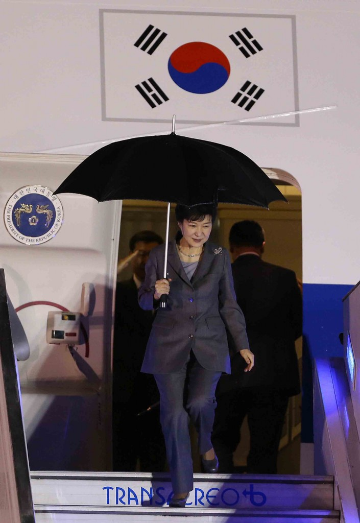 South Korean President Park Geun-hye descends from the plane upon her arrival to the military airport in Bogota, Colombia, Thursday, April 16, 2015. Park Geun-hye is in Colombia in an official two-days visit and will then tour Peru, Chile and Brazil. (AP Photo/Fernando Vergara)