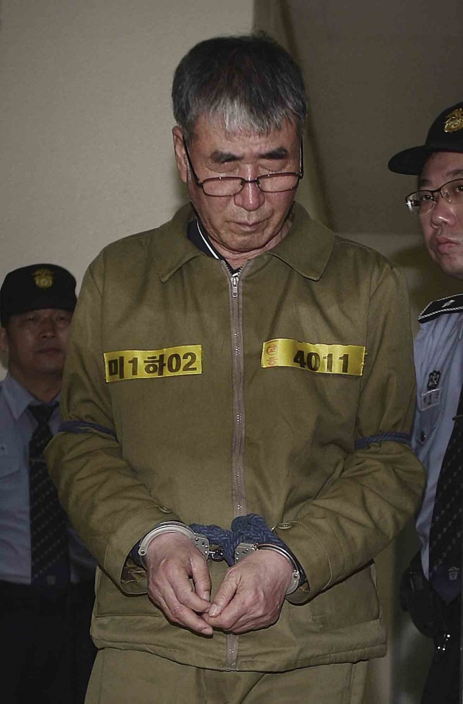 Lee Joon-seok, the captain of the sunken South Korean ferry Sewol, arrives for verdicts at Gwangju High Court in Gwangju, South Korea, Tuesday, April 28, 2015. The South Korean appellate court on Tuesday handed down a sentence of life in prison to Lee. The sentencing is harsher than a November verdict by a district court that sentenced Lee to 36 years in prison for negligence and abandoning passengers in need. (Park Chul-hong/Yonhap via AP)
