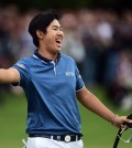 South Korea's Byeong Hun An gestures, after winning the 2015 BMW PGA Golf Championship, at the Wentworth golf club, in Virginia Water, England, Sunday May 24, 2015. (Adam Davy/PA via AP)