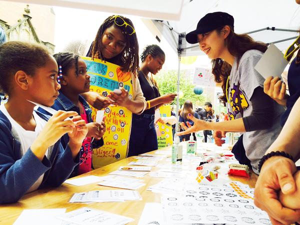 Students attend the Korean Street Festival on 134th Street in Harlem Saturday (Korea Times)