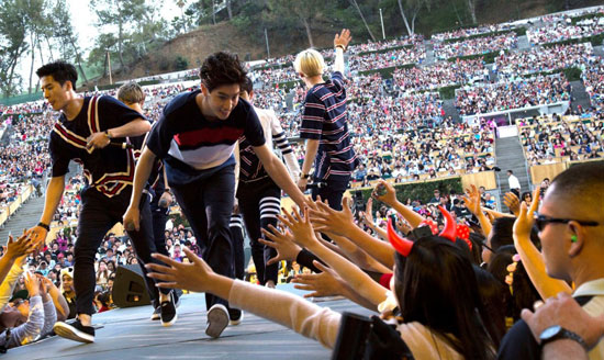 Members of Got7 greet fans during their first performance at the Hollywood Bowl Saturday for the 13th Korea Times Music Festival. (Korea Times)