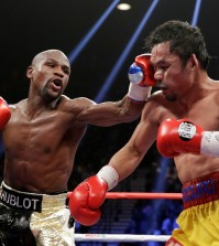 Floyd Mayweather Jr., left, hits Manny Pacquiao, from the Philippines, during their welterweight title fight on Saturday, May 2, 2015 in Las Vegas. (AP Photo/Isaac Brekken)