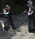 Chinese tourists jump for a photograph on Ewha Womans University campus in Seoul, Monday. (Korea Times photo by Choi Won-suk)