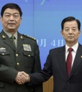 Chinese Defense Minister Chang Wanquan, left, poses with his South Korean counterpart Han Min-goo for photographers prior to a meeting at the Defense Ministry in Seoul. (AP Photo/Ed Jones, Pool)